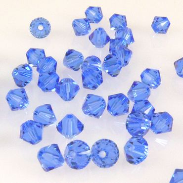 100x SWAROVSKI ELEMENTS 5328 Bicone 4mm sapphire Glasperlen blau Doppelkegel